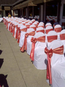 Coral Taffeta Sashes for an outdoor summer wedding ceremony.