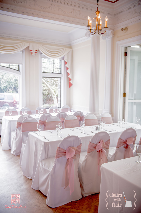 Pink & Latté organza sashes on white banquet chair covers
